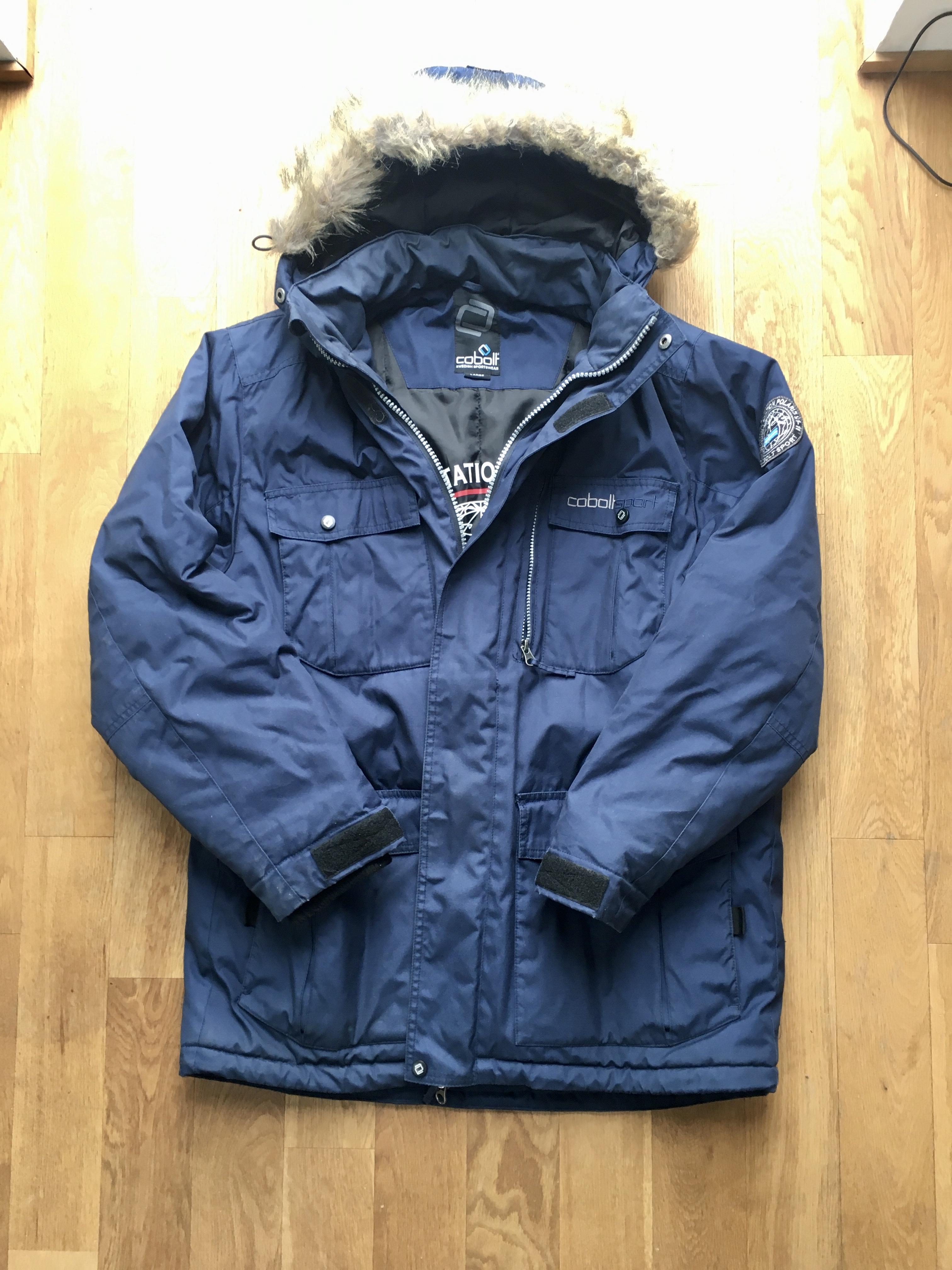 Warme blaue Winterjacke, wie neu tauschen