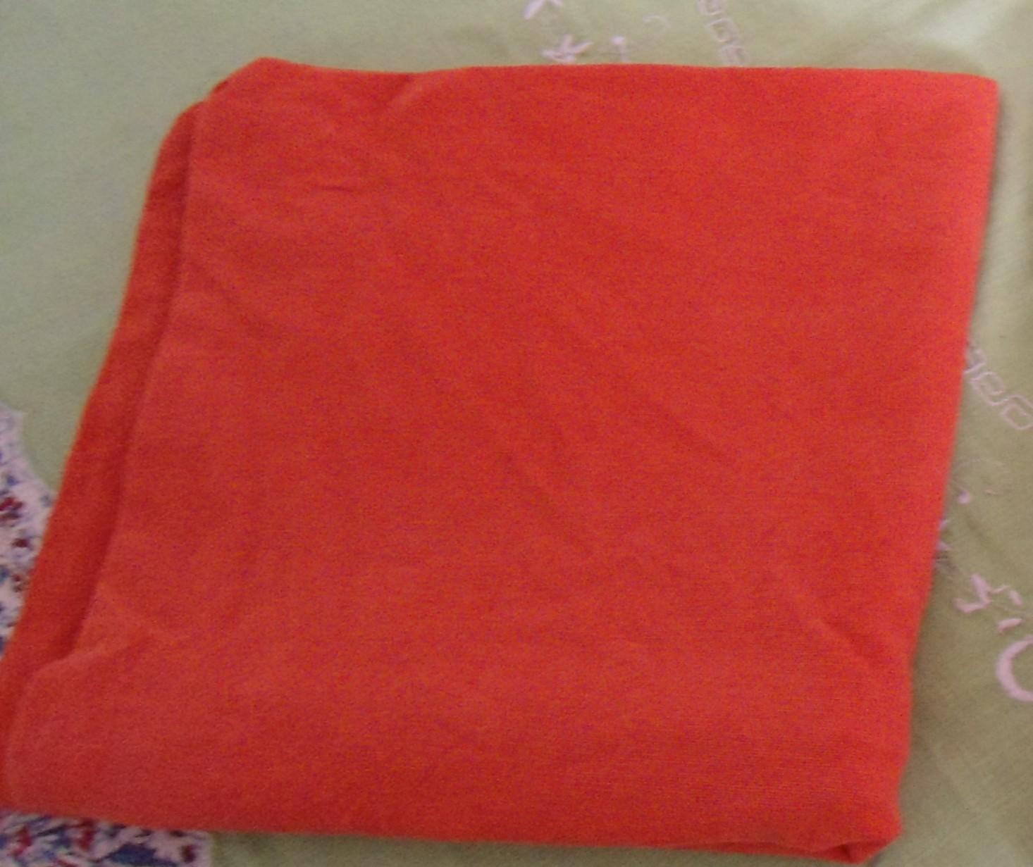 2 orange Baumwollkissenbezüge tauschen