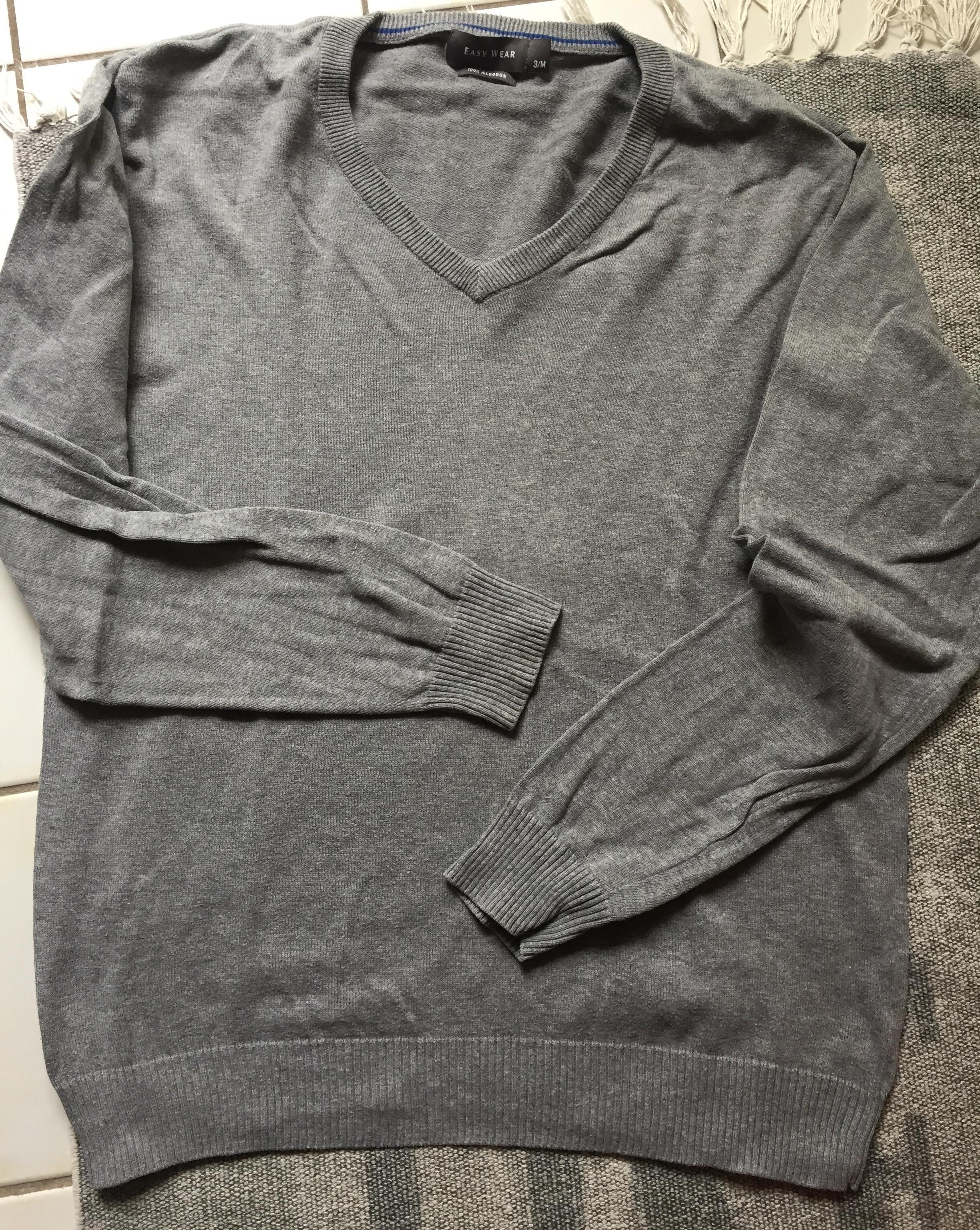 Grauer Pullover tauschen